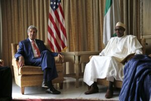 Photo by: Akintunde Akinleye U.S Secretary of State John Kerry sits beside Muhammadu Buhari, Nigeria's former military ruler and opposition party All Progressives Congress (APC) presidential candidate at the U.S. consulate house in Lagos, Nigeria, Sunday, Jan. 25, 2015. In a rare high-level visit to Africa's most populous country, Mr. Kerry on Sunday urged Nigeria's leading presidential candidates to refrain from fomenting violence after next month's vote, and he condemned savage attacks by Boko Haram, an al Qaeda-linked insurgency. (AP Photo/Akintunde Akinleye, Pool)