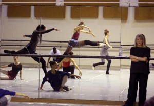 """South African choreographer Veronica Paeper, right, watches dancers rehearse for the show """"A Spartacus in Africa"""" in Cape Town, South Africa, Thursday, April 2, 2015. A new South African production of the ballet, """"A Spartacus in Africa,"""" will incorporate African dance styles with classical and contemporary dance for a story that its producers say resonates on a continent with its own history of oppression. (AP Photo/Schalk van Zuydam)"""