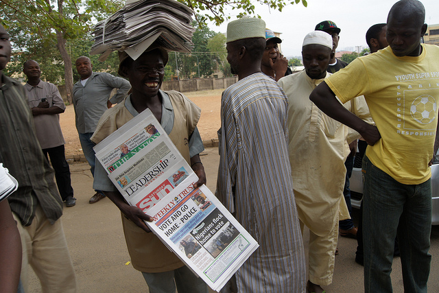 A newspaper vendor in Nigeria. Photograph by The Commonwealth.