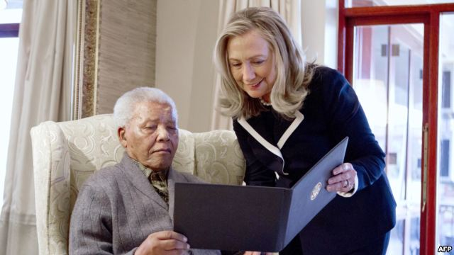 US-Secretary-of-State-Hillary-Rodham-Clinton-meets-with-Nelson-Mandela-94-former-president-of-South-Africa-at-his-home-in-Qunu-South-Africa-on-August-6-2012..