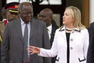 "1. US Secretary of State Hillary Clinton meets with Kenyan President Mwai Kibaki at the State House in Nairobi. Clinton has urged Kenyans to work together to ensure ""transparent"" elections next year and avoid a repeat of the deadly post-poll violence four years ago. Clinton has urged Kenyans to ensure ""transparent"" elections next year and avoid a repeat of the post-poll violence four years ago. (AFP Photo/Jacquelyn Martin)"