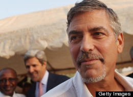 American actor George Clooney attends voting ceremonies during the first day of voting for the independence referendum in the southern Sudanese city of Juba January 9, 2011 in Juba, Sudan. (Photo by Spencer Platt/Getty Images)