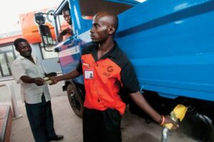 Filling a truck with diesel fuel at a Ghana Oil station in Accra: One of Africa's newest oil producers, Ghana has put into place laws and institutions to help ensure that oil revenues are not wasted or diverted, but benefit the country's development. Photo: Panos/Jenny Matthews