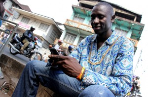 Harry Kargbo helped monitor Sierra Leone's recent presidential election using his cell phone [Travis Lupick/Al Jazeera]
