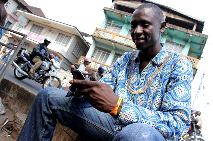 Harry Kargbo helped monitor Sierra Leone's recent presidential election using his cell phone [Travis Lupick/Al Jazeera]