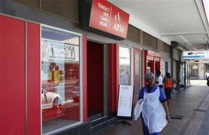 A woman walks past a branch of South Africa's biggest retail bank, Absa, in Cape Town, in this December 6, 2012 file photo.  REUTERS/Mike Hutchings/Files