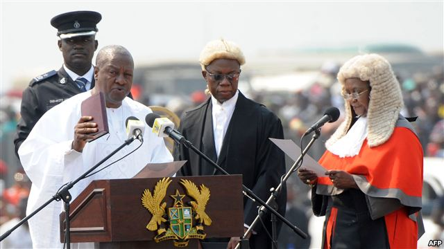 Ghanaian President John Mahama is sworn-in by Chief Justice Georgina Wood (R) at Independence Square, Accra, January 7, 2013