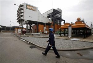 A man walks in front of a plant of Ivory Coast power company Ciprel in Abidjan in this June 12, 2012 file photo.  REUTERS/Thierry Gouegnon/Files