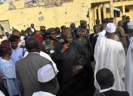 President Jonathan stands with gov't officials during his visit to the police HQ in the  Northern city of Kano in Jan 2012,following a bomb attack..Photo Reuters/Stringer