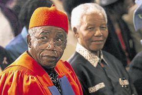 HISTORY OF AFRICAN HUMANISM: Nigerian author Professor Chinua Achebe receives an honorary doctorate from the University of Cape Town. Next to him is former president Nelson Mandela. Both leaders have given the gift of ubuntu to the world