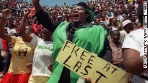 ubilant residents of Soweto wait to hear newly freed Nelson Mandela speak at Orlando stadium February 12,1990. I