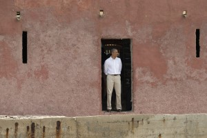 U.S. President Barack Obama looks out to sea through the 'Door of No Return,' at the slave house on Goree Island, in Dakar, Senegal, Thursday, June 27, 2013. Obama is calling his visit to a Senegalese island from which Africans were said to have been shipped across the Atlantic Ocean into slavery, a 'very powerful moment. AP Photo/Rebecca Blackwell)