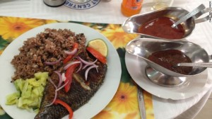 A culinary marvel found in Accra, grilled tilapia with waakye and tomato sauce