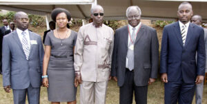 PHOTO | KIBAKI PRESS Former president Mwai Kibaki poses for a group photo with the Great Lakes Student Leaders after presenting him with The Great Lakes Region Student Union Medal during the 90 years of Makerere University Celebrations in Kampala, Uganda.  NATION MEDIA GROUP