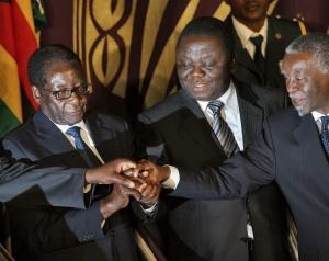Mbeki with Zimbawean Leaders. President Mugabe now wields power alone