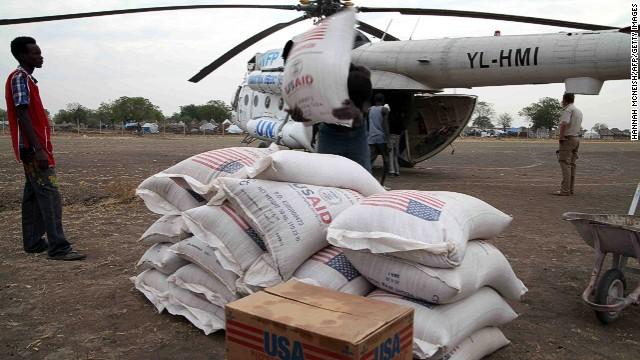 People in Jonglei state, South Sudan, unload aid from the U.N. World Food Program in January 2012