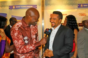 Roger Muntu in doing an interview with Ghanaian Actor Majid Michel at the movie premiere of One Night in Vegas
