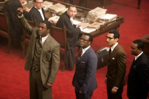 Idris Elba, Tony Kgoroge, Riaad Moosa and Zolani Mkiva in 'Mandela: Long Walk to Freedom.' Weinstein Co.