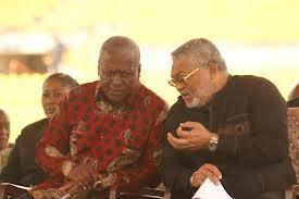 President John Mahama and former President Rawlings in glasses