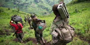 M23 rebels withdraw through the hills having left their position in the village of Karuba, eastern Democratic Republic of Congo on November 30, 2012. M23 accused Kinshasa and the international community of ganging up against them. Photo/AFP
