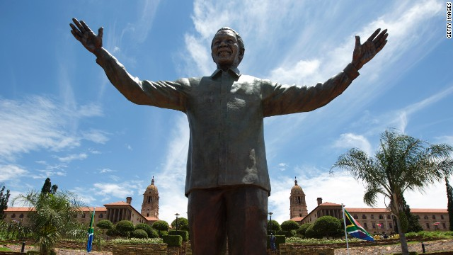 A statue of former South African president Nelson Mandela is unveiled at the Union Buildings in Pretoria on December 16, 2013.