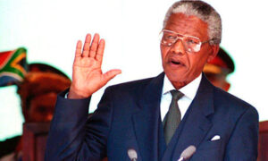 Nelson Mandela takes the oath during his inauguration as South African president in Pretoria on 10 May 1994. Photograph: Walter Dhladhla/AFP/Getty Images
