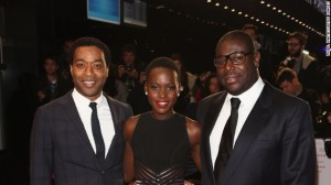 "Nyong'o pictured with ""12 Years"" star Chiwetel Ejiofor (left) and director Steve McQueen (right) at the movie's European premiere, at the London Film Festival on October 18, 2013"