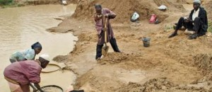 Artisanal diamond miners at work in the alluvial diamond mines around the eastern town of Koidu, Sierra Leone. While the continent is rich in mineral and oil wealth, Africa's majority may have to wait a long time before they benefit from this. TOMMY TRENCHARD   IPS