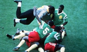 Cameroon players pile on top of each other as they celebrate the only goal. Photograph: Bob Thomas/Bob Thomas/Getty Images