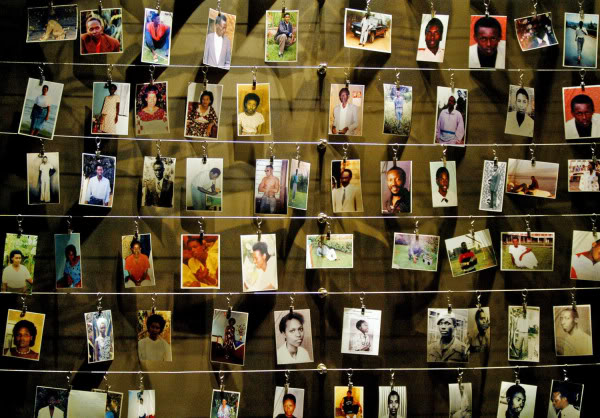 Pictures of killed people donated by survivors are installed on a wall inside the Gisozi memorial in Kigali April 5, 2004 which depicts the country's 1994 genocide in which 800,000 Tutsi and politically moderate Hutus died. Rwandans hungry for justice demanded tougher efforts to track down and punish killers who carried out the 1994 genocide, saying there could be no reconciliation while suspects were still at large. REUTERS/Rad