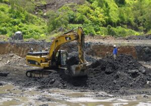 SOURCE: CORBIS  AN EXCAVATOR AT THE BOTTOM OF CONGOLESE STATE MINING COMPANY GÉCAMINES' KAMFUNDWA OPEN-PIT COPPER MINE