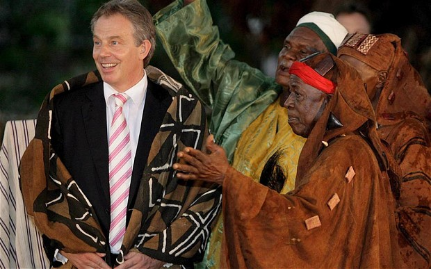 Tony Blair (L) wears a ceremonial robe after being made an Honorary Paramount Chief of Mahera Village on 30 May 2007 near Freetown, Sierra Leone. His charity has been given £3m for aid work in Africa by the US Government. Photo: EPA
