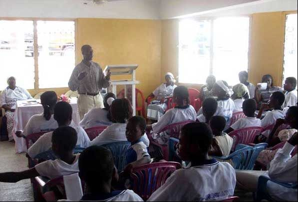 A man gives a talk about the importance of abstinence at a Virgins Club in Ghana to an audience comprising only female members. The Virgins Club is a sub-organisation of the Methodist Church.