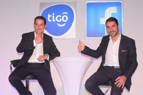 It's thumps up by Tigo Tanzania General Manager, Diego Gutierrez (L), and Facebook representative, Nicola D'Elia, during the launch of a historic partnership between their two companies today in Dar es Salaam