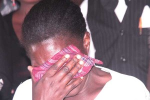 A woman breaks down in tears after seeing the body of a relative who died after drinking the lethal brew that has so far claimed 76 lives. PHOTO | CHARLES WANYORO  NATION MEDIA GROUP