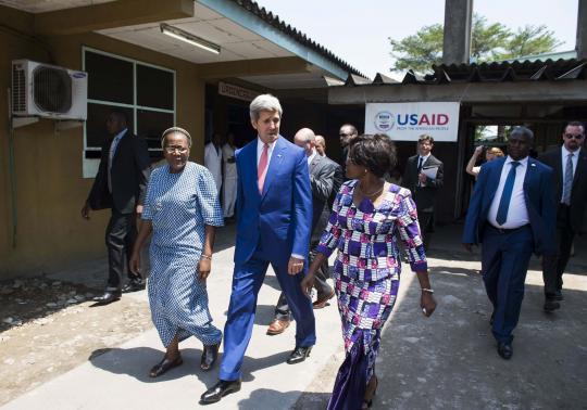 U.S. Secretary of State John Kerry (C) walks alongside Hospital Director Dolores Nembunzu (R) and Sister Mary Joseph (L) at the Fistula Clinic at Saint Joseph's Hospital, funded by USAID, in Kinshasa May 4, 2014.