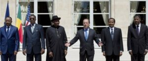 (LtoR) Niger's president Mahamadou Issoufou, Chad's president Idriss Deby Itno, Nigeria's president Goodluck Jonathan, France's president Francois Hollande, Cameroon's president Paul Biya, and Benin's president Thomas Boni Yayi pose for a photo during an African security summit to discuss the threat of Nigerian Islamist militant group Boko Haram to the regional stability, at the Elysee Palace in Paris on May 17, 2014. (ALAIN JOCARD/AFP/Getty Images) | ALAIN JOCARD via Getty Images