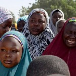 Mothers of kidnapped school girls listen to local officials during a meeting with the Borno State governor in Chibok on April 22, just over a week after the kidnappings. Photo: Reuters
