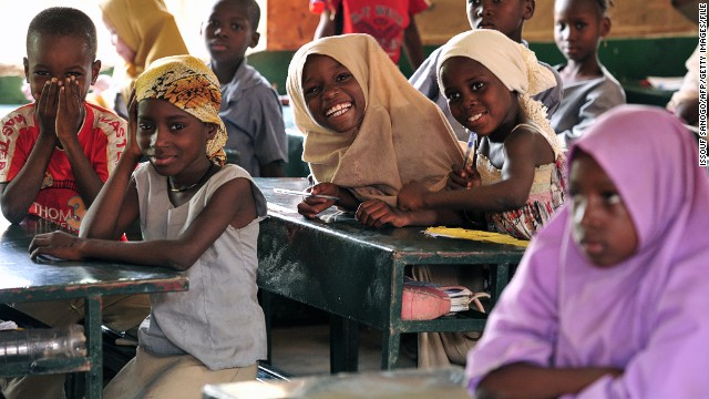 Children pose in a classroom at the Friendship Primary school in Zinder, Niger, on June 1, 2012