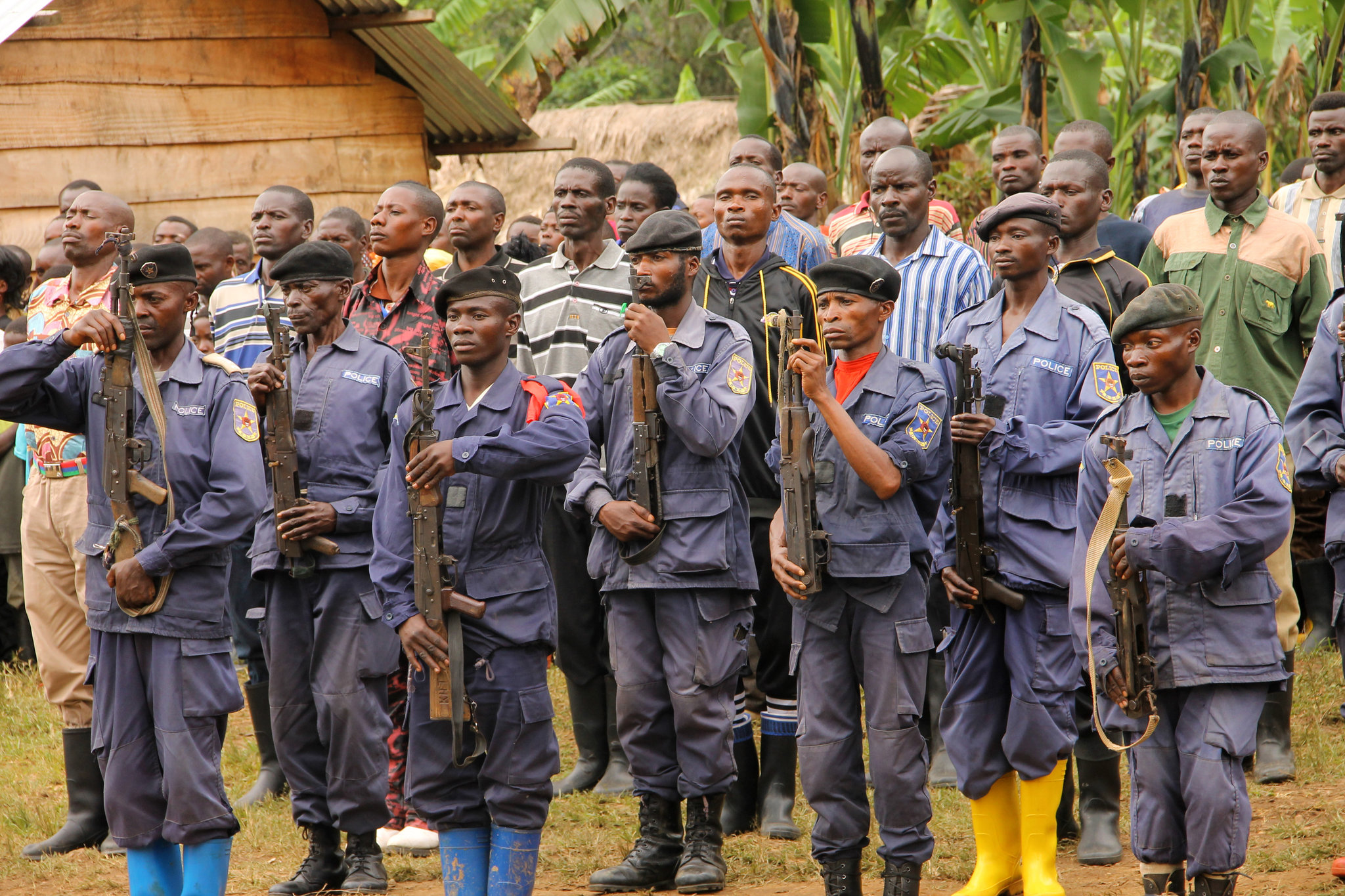 Congolese national police officers in front of the 83 Democratic Forces for the Liberation of Rwanda guerrillas who surrendered in Kigogo. SARAH FLUCK FOR THE NEW YORK TIMES