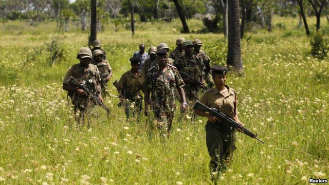 Kenyan police officers patrol Mavuno villages near Mpeketoni after unidentified gunmen recently attacked the coastal Kenyan town of Mpeketoni, June 17, 2014.