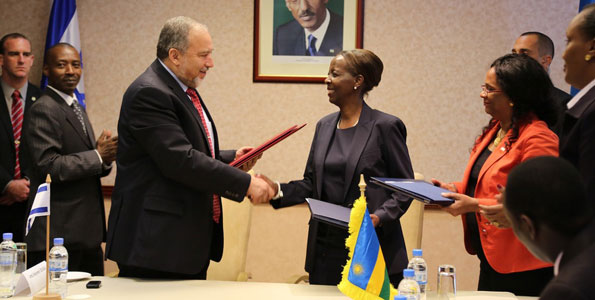 sraeli Minister for Foreign Affairs Avigdor Liberman and his Rwanda counterpart Louise Mushikiwabo exchange MoU documents on a Business and Investment pact between their countries in Kigali. Photo/Daniel Sabiiti