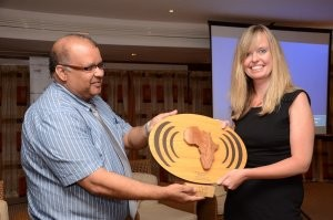 Rebecca Davis receives the award trophy from Dr. Anil Deelchand, Ag. Director of General Health Services in the Ministry of Health and Quality of Life, Republic of Mauritius.
