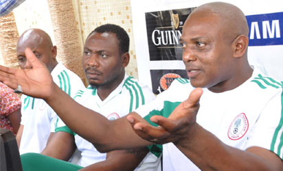 From Left: National Team Goalkeeper Trainer, Ike Shorunmu; Assistant Coach, Daniel Amokachi, and Super Eagles Chief Coach, Stephen Keshi during a media parley in Abuja