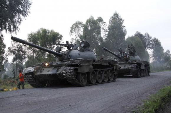 Soldiers from the Democratic Republic of Congo (DRC) arrive in tanks near the town of Kibumba at its border with Rwanda after fighting broke out in the Eastern Congo town June 11, 2014. Credit: Reuters/Kenny Katombe