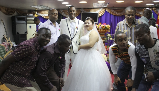 JENNIFER TSANG AND EMAN OKONKWO AT THEIR WEDDING IN GUANGZHOU IN APRIL. PHOTO: JENNI MARSH