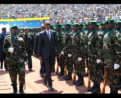 President Kagame inspects a Guard of Honour mounted by the Rwanda Defence Forces at Amahoro Stadium yesterday. Village Urugwiro.