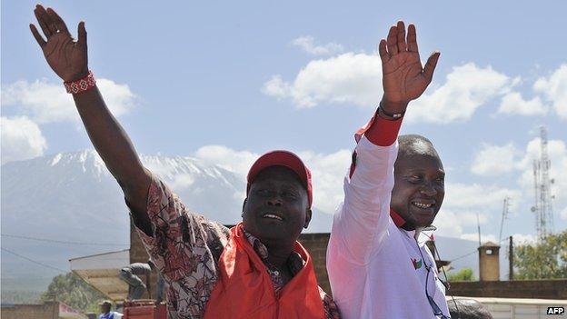 Kenya's President Uhuru Kenyatta (R) won disputed elections in 2013