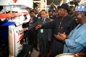President Goodluck Jonathan presses button to commission the Bagging  Section of Olam Rice Farm Nigeria  in  Rukubi  Nasarawa State  on Monday  14th July, 2014