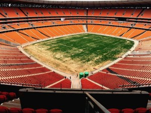 Before the tournament: The flagship Soccer City in Soweto, aka First National Bank Stadium. South Africa's monopoly capitalist construction firms and their Black Economic Empowerment allies inflated prices, rigged tenders, and registered a 100% increase in their profits from 2004 to 2009